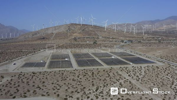Wind Turbines and Solar Cells In Palm Springs Desert California Drone Aerial View