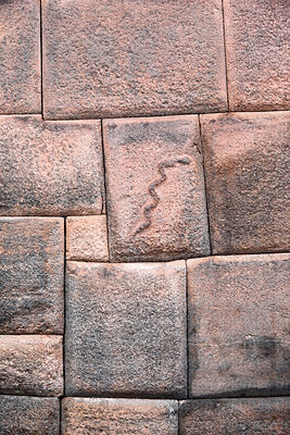Snake carved in Inca stonework of the Nazarenas Palace, Cusco, Peru