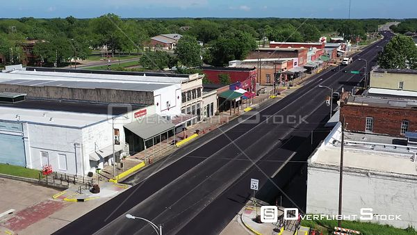 Highway Traffic Passing Through an Empty Old Downtown, Calvert, Texas, USA