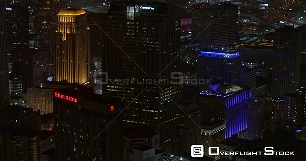 New Orleans Louisiana Aerial Flying around tall buildings in business district at night