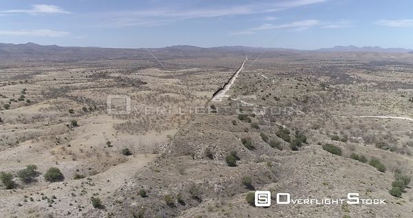 Drone Video Border Wall Nogales Arizona Sonora Mexico. End of Wall in Desert