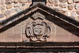 Carmelite cross stone carving above main entrance of Santa Teresa church, Cusco, Peru