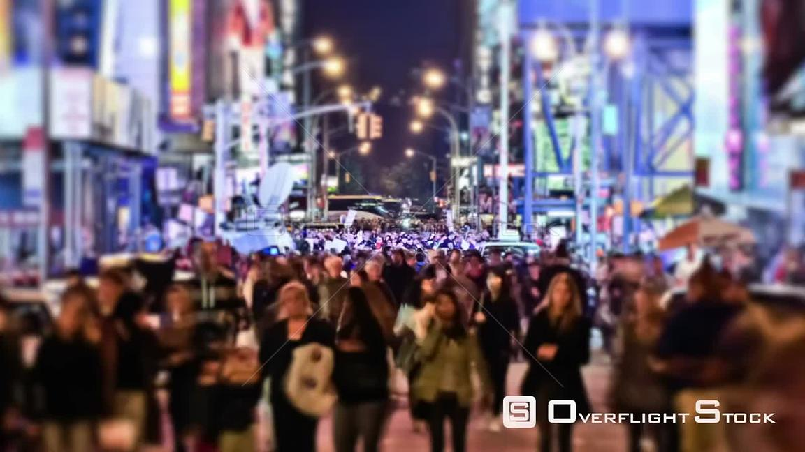 NYC New York USA Zooming busy city pedestrian traffic time lapse of Times Square area using a circular blur effect.