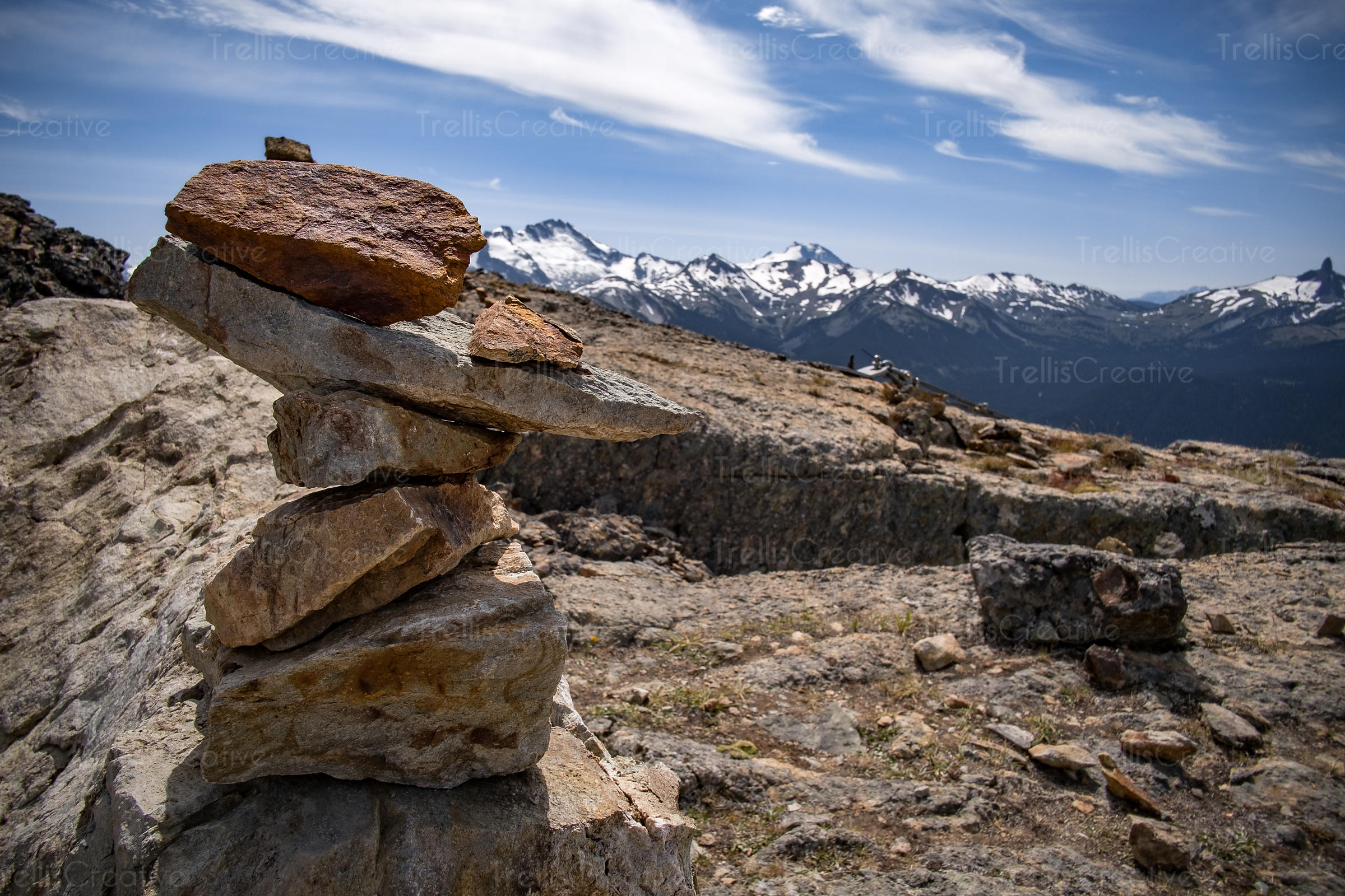 Stone cairn on top of a mountain peak, Blackcomb Mountain, Whistler, Canada.