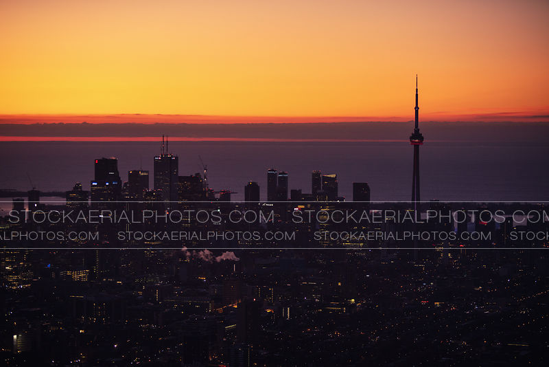 Silhouette of downtown Toronto's skyline during sunrise