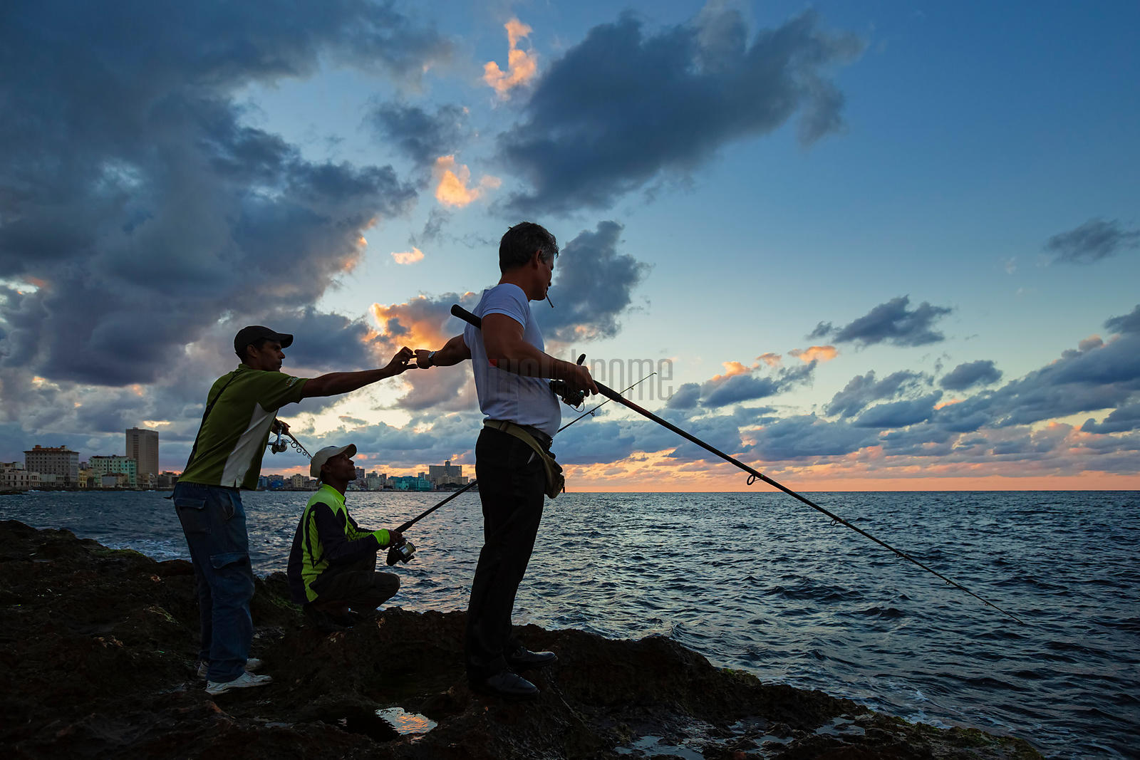 Local Fishermen at the Malecón at Dusk