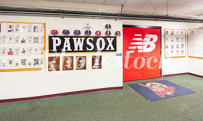 PawSox Photos and Memorabilia On Wall Next To New Balance Logo on Door