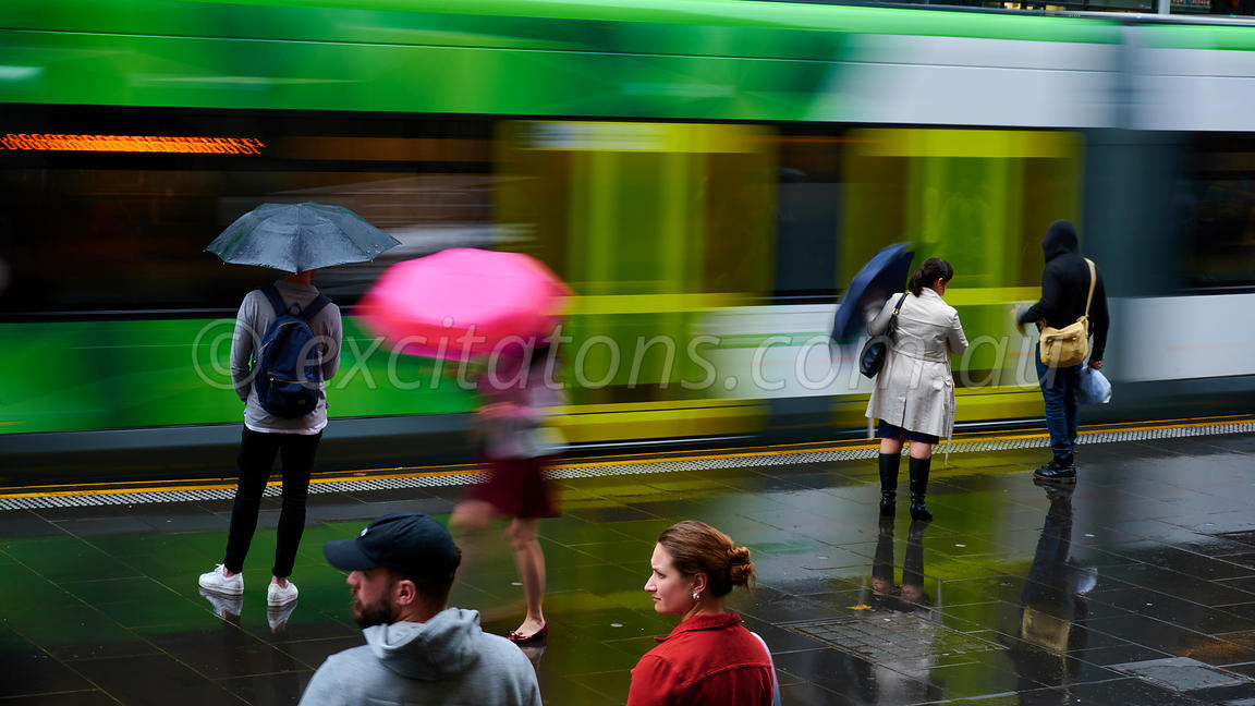 Waitiing for a tram, wet day in Melbourne.