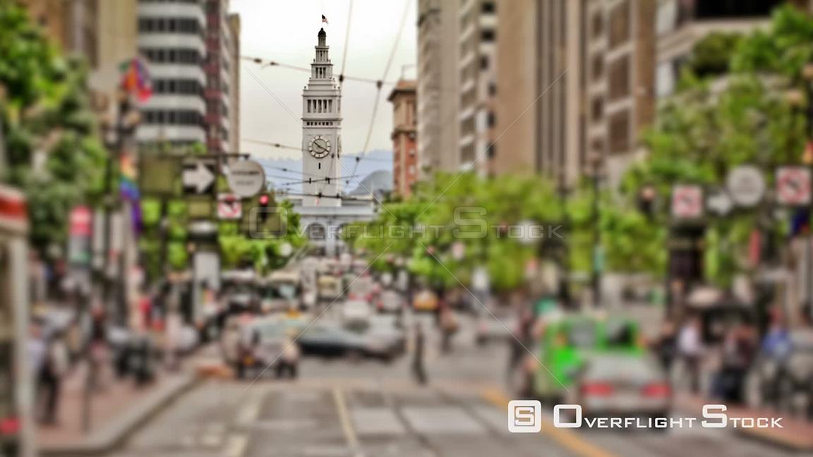 San Francisco California City traffic time lapse using a unique photo and tilt shift effect. Clock tower in focus.