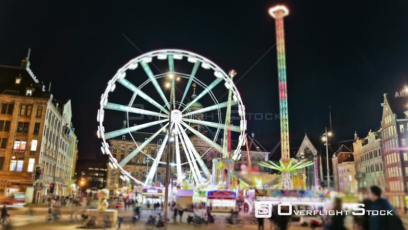 City fair and Ferris Wheel time lapse in downtown Amsterdam Netherlands