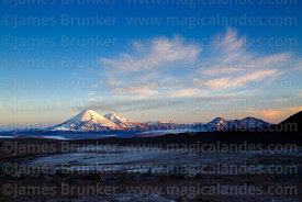 View of Payachatas volcanos at sunrise from Guallatiri volcano base camp, Lauca National Park, Region XV, Chile