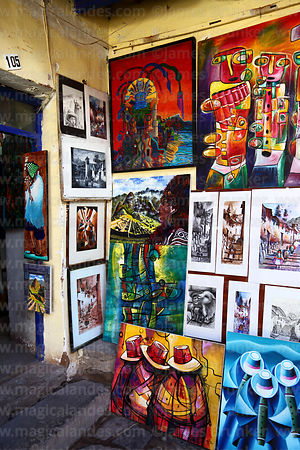 Paintings for sale in art galley, Cusco, Peru