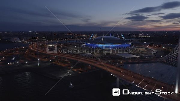 Straight Forward Night Shot of Football Stadium Zenit Arena and Circle Road. Saint Petersburg Russia Drone Video View
