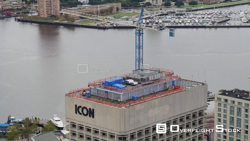 Norfolk Virginia Aerial Panning around building construction with harbor views