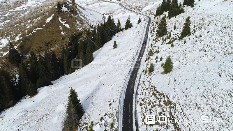 Car driving on a mountain road during winter. Romania