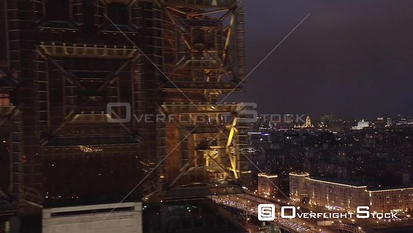 Dusk Fly Pass by the Ras With Moscow Cityscape City Lights. Moscow Russia Drone Video View