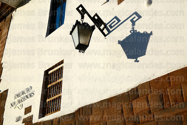 Street light and shadow on wall of the Nazarenas Palace, Cusco, Peru