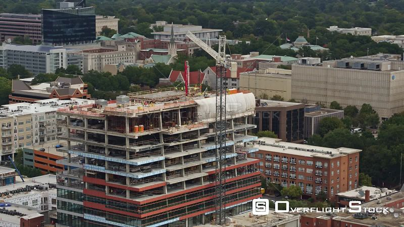 North Carolina Raleigh Aerial Panning around downtown construction with cityscape views in backdrop
