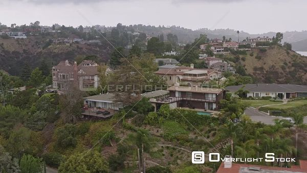 Los Angeles Panning around close up to high around hillside mansion residential neighborhood