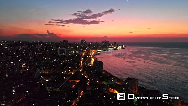 Cuba Havana Flying backwards, quickly over Old Havana with Malecon and water views at dusk