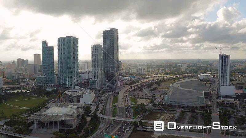 Miami Florida Flying over bay and downtown panning with cityscape views.