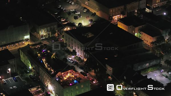 South Carolina Charleston Aerial Birdseye night view low detail over French Quarter bar club