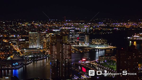 Baltimore Maryland Aerial Nighttime panoramic cityscape from water view to inland