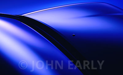 Dramtic Blue-Toned Detail of An Automobile Hood and Windshield