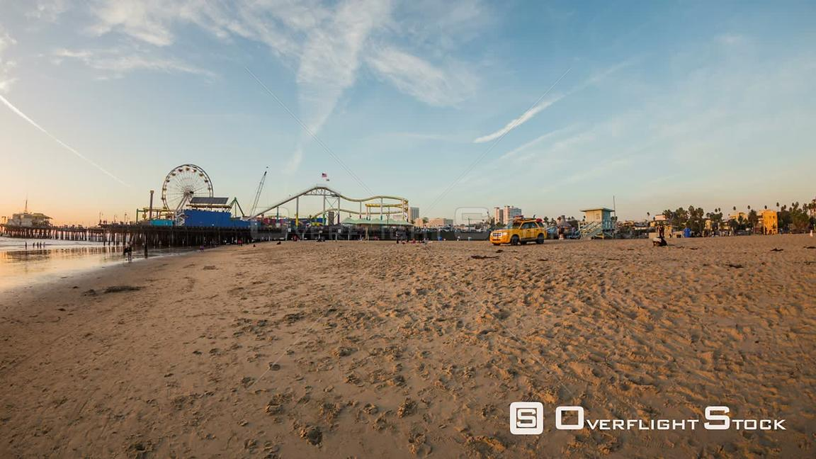 Los Angeles California USA Santa Monica Pier panning time lapse during sunset