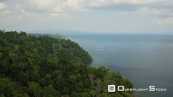 Flying low over large ocean bay and jungle forests. Costa Rica