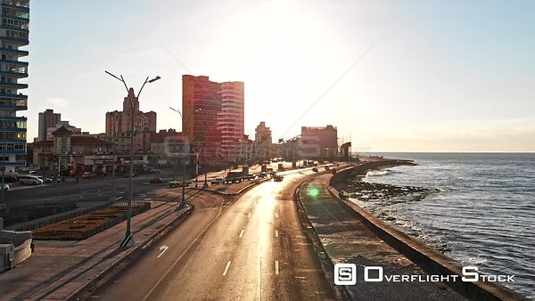 Cuba Havana Low detail avenue view following path of Malecon looking into sun