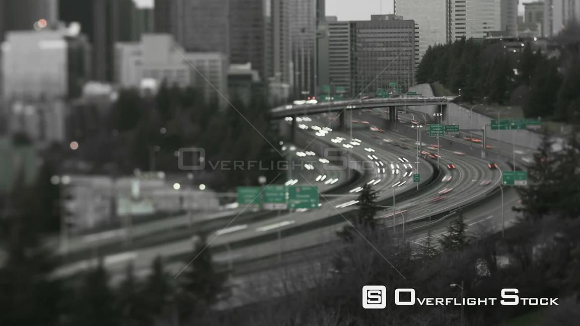 Seattle Washington State USA Seattle I5 traffic time lapse with cityscape in background at dusk using a tilt shift lensBlack ...