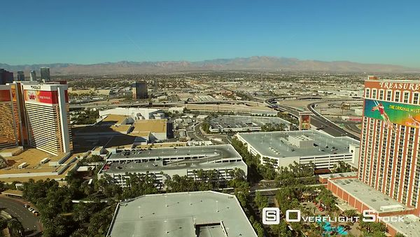 Low flying aerial over strip towards suburbs Las Vegas Nevada