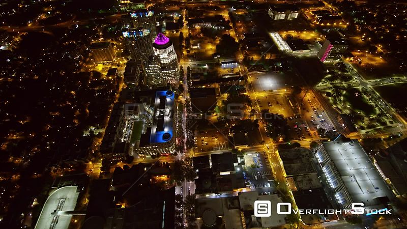 North Carolina Charlotte Aerial Birdseye cityscape view traveling toward downtown at night