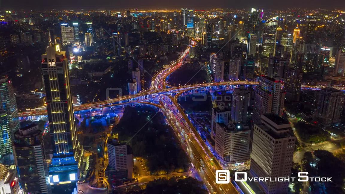 China Shanghai Aerial Hyperlapse at night, high birdseye view of freeway intersection