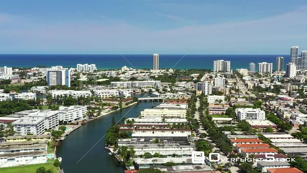 Aerial push in shot Miami Beach condominiums and apartments waterfront 4k
