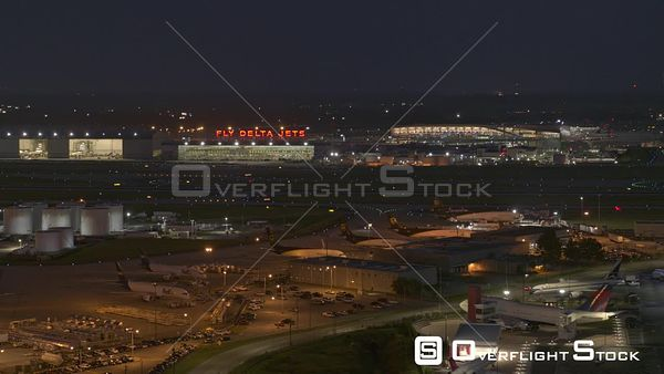Atlanta Flying slow and low overtop Delta hangars and airport motel cityscape with airport in backdrop