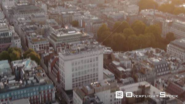 City of London Skyline and London Eye, filmed by drone in autumn, at sunrise, London, United Kingdom