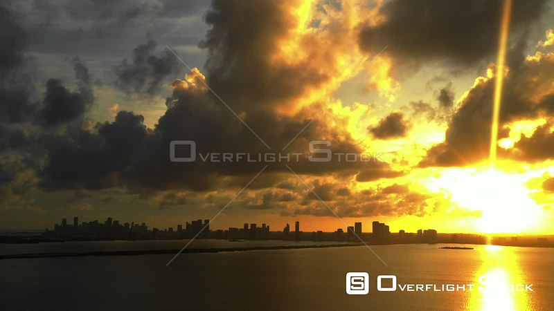 Aerial panning shot sunset over Downtown Miami and Biscayne Bay FL USA
