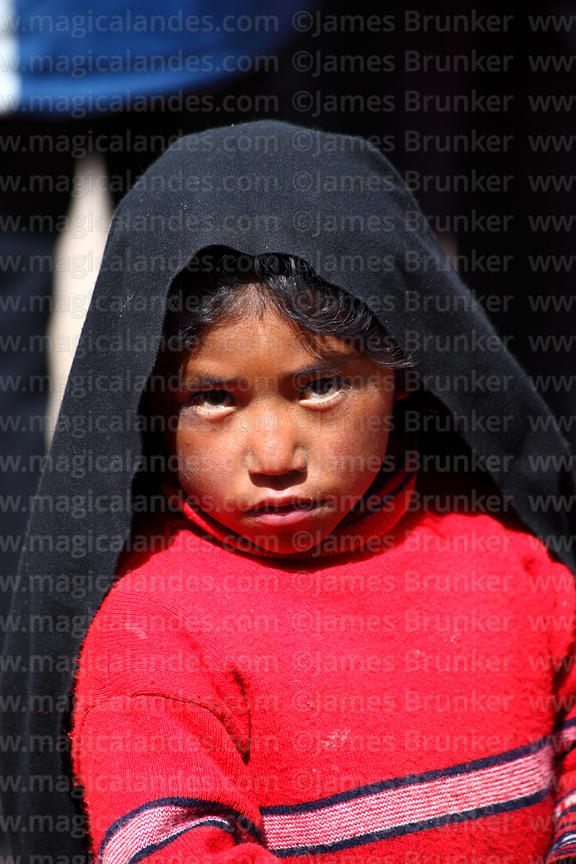 Young Quechua girl wearing traditional black headress worn by single females, Taquile Island, Peru