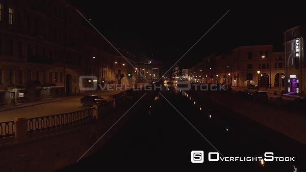 Late Night Slow Forward Shot Flying Low Over the Old Bridge With Griffons in the City Center. Saint Petersburg Russia Drone V...