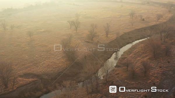 Bare Trees in Haze, Grasses and a Creek, Lincoln, Nebraska, USA