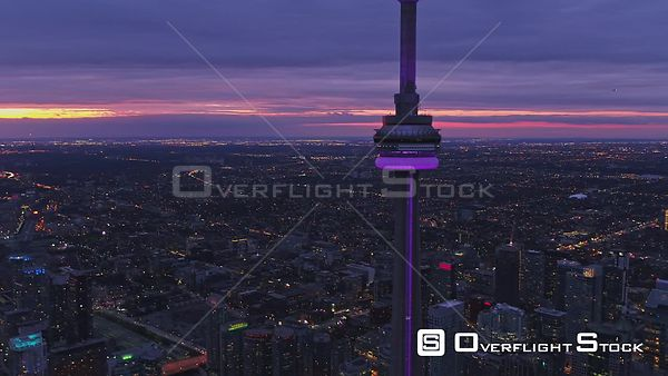 Toronto Ontario Flying in reverse to CN Tower then descending cityscape view with tower details at sunset