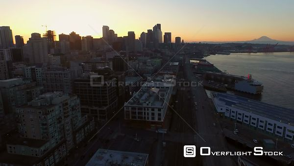 Seattle Washington State USA Flying low over waterfront area with cityscape views at sunrise