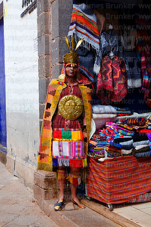 Inca statue in entrance of souvenir shop, Cusco, Peru