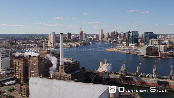 Baltimore Maryland Aerial Flying over and around Locust Point supplier building with downtown cityscape in background
