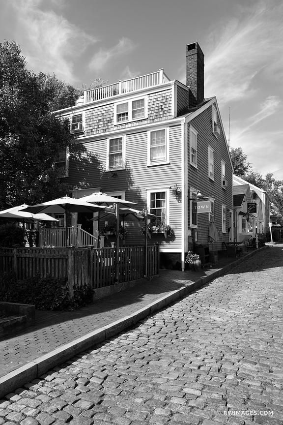 COBBLESTONE STREET HISTORIC NANTUCKET MASSACHUSETTS BLACK AND WHITE VERTICAL