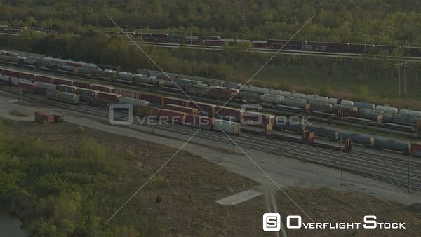Mobile Alabama View of train wagons at the train yard panning up to downtown cityscape  DJI Inspire 2, X7, 6k