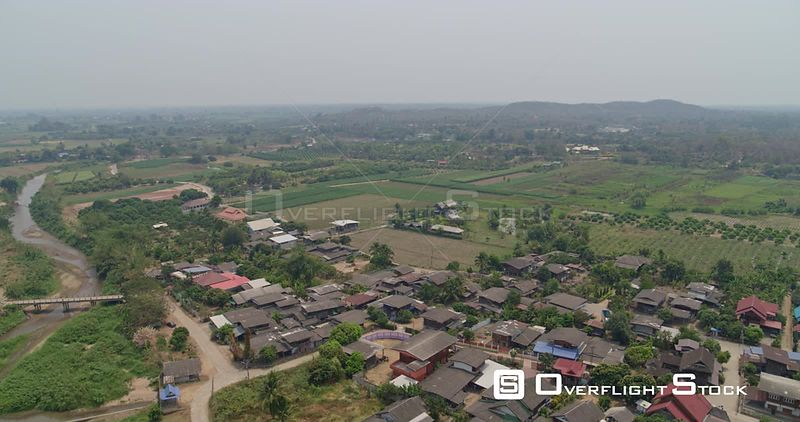 Thung Pi Thailand Aerial Panning birdseye to reverse view of village and waterways
