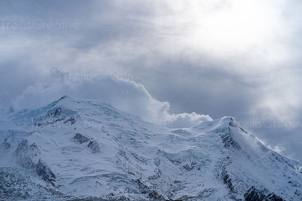 Wind blows clouds and snow over the summit of Mont Blanc